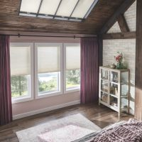 "Skylights: 3/4"" Single Cell SkyTrack™ Skylight Cellular Shades with Cordless Lift: Fanfare, Cosmic Light 0692 Windows: 3/4"" Single Cell Cellular Shades with Cordless Lift: Fanfare, Cosmic Light 0692 Drapery: Pinch Pleat Drapery: Luminous, Majestic 2250   Hardware: 1 3/8"" Opulence Wood Traverse Pole with Kirtling Finials: Regal Walnut 409"