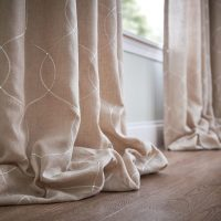 Window Drapes puddling on the floor in a Nashville Home.