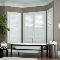 Plantation Shutters used as window coverings in bathroom by Pinnacle Custom Window Coverings