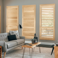 Shutters in Natural wood finishing by Pinnacle Custom Window Coverings