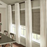 Nashville Curtains installed White Drapes over shades.